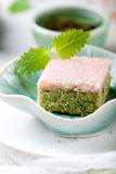 Matcha green tea cakes with white chocolate glaze Stock Images
