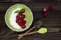 Free Matcha Green Tea Chia Seed Pudding Bowl, Vegan Dessert With Raspberry And Coconut Milk. Overhead, Top View, Flat Lay. Royalty Free Stock Photo - 84856185
