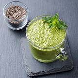 Matcha green tea chia seed pudding, dessert with fresh mint and coconut. Healthy breakfast Royalty Free Stock Photo