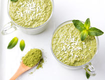 Matcha green tea chia seed pudding, dessert with fresh mint and coconut Healthy breakfast Top view Copy space Royalty Free Stock Photography