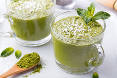 Matcha green tea chia seed pudding, dessert with fresh mint and coconut on a white stone background Healthy breakfast Stock Photo