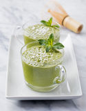 Matcha green tea chia seed pudding, dessert with fresh mint and coconut on a white stone background Healthy breakfast Stock Photos
