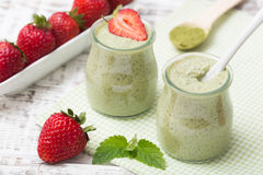 Matcha green tea chia seed pudding, dessert with fresh mint and Royalty Free Stock Photo