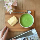 Matcha Green Tea and cookie on wooden tray. Stock Image
