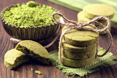Matcha green tea cookies. On a wooden table Royalty Free Stock Images