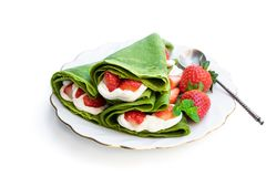 Matcha green tea crepe with whipped cream and strawberry isolated on white. Matcha  green tea crepe with whipped cream and strawberry isolated on white stock photos