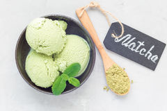 Matcha green tea ice cream balls in a black bowl, horizontal, top view Stock Photo