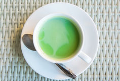 Matcha green tea latte beverage. In glass on table Stock Photos