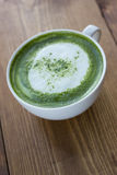 Matcha green tea latte beverage in glass. Stock Image