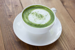 Matcha green tea latte beverage in glass. Stock Photos