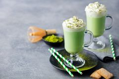Matcha green tea latte with whipped cream. Copy space. royalty free stock photos
