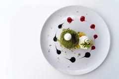 Matcha Green Tea Macadamia Cake. On a white table. Free space for text . Top view Stock Photos
