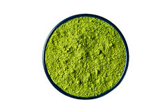 Matcha green tea powder isolated on white, clipping path include. Ground matcha green tea powder in a round cast iron cup, isolated on white background, clipping royalty free stock photography