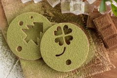 Matcha Green tea powder on a printed form and Chocolate on a woo