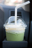 Matcha green tea. Smoothie in car stock image