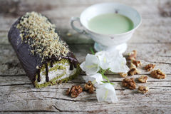 Matcha green tea swiss roll with whipped cream with walnuts Stock Photography