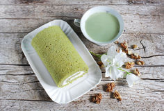Matcha green tea swiss roll with whipped cream with walnuts Stock Photo