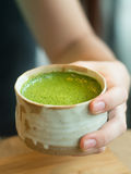Matcha Green Tea in woman hand. Royalty Free Stock Image