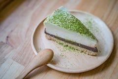 Matcha groene thee en chocoladekaastaart Stock Fotografie
