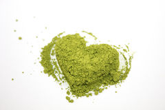 Matcha heart green tea. Matcha green tea in the shape of heart on white background Royalty Free Stock Image