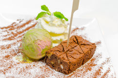 Matcha ice-cream and brownie with wipcream Royalty Free Stock Photo