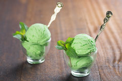 Matcha ice cream in cup. Scoop of matcha ice cream in cup on rustic old wooden vintage background royalty free stock images