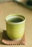 Matcha Japanese healthy drink. Hot Green tea drinking Stock Photos