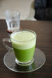 Matcha latte. On the wooden Table Stock Photography