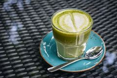 Matcha latte in glass royalty free stock photos