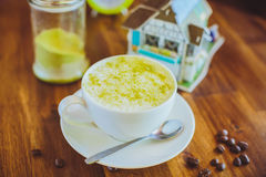 Matcha Latte on a wooden table in  cafe Royalty Free Stock Photo