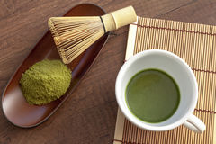 Matcha original, Japanese style with some green tea powder and t. Ools for tea making on wooden table Stock Image