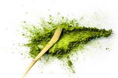 Matcha powder spread with a chashaku spoon. Matcha is made of finely ground green tea powder. It`s very common in japanese culture. Matcha is healthy due to it Royalty Free Stock Images
