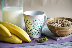 Matcha smoothie ingredients of milk, oats and bananas Royalty Free Stock Images