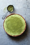 Matcha tart with cream cheese filling over a metal background Stock Photography
