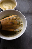 Matcha tea with bamboo whisk Stock Photo
