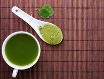 Matcha tea on the brown mat Stock Photos