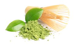 Matcha tea, green leaves and bamboo whisk Stock Photography