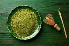 Matcha tea powder bamboo chasen and spoon Stock Photos