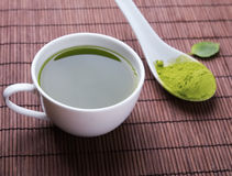 Matcha tea in a white cup on the mat Stock Photography