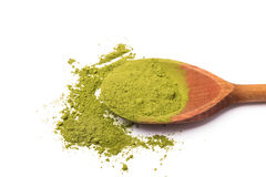 Matcha tea in a wooden spoon on white background Royalty Free Stock Photos