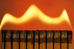 Matchbook Fire. Traveling Matchbook Fire, Dark Fire experiment, single matchbook seperated, home studio Stock Images