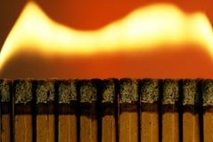 Matchbook Fire. Traveling Matchbook Fire, Dark Fire experiment, single matchbook seperated, home studio Stock Photos