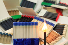 Matchbooks and fired Paper Stick with flame. Group of different models, styles, sizes and colours Matchbooks (Book of Matches) and fired Paper Stick with flame Stock Image