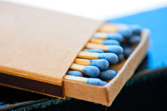 Matchbox with blue heads. Close-up royalty free stock images