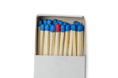 Matchbox with blue and one red matches Royalty Free Stock Image