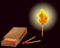 Matchbox and lighted match Stock Photography