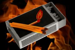 Matchbox with matches. In front of burning fire Royalty Free Stock Photos