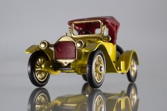 British toy car 1913 Cadillac, gold, front view royalty free stock image