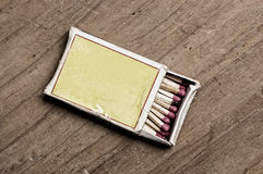 Matchbox on old table. Matchbox on old table, closeup shot royalty free stock photography