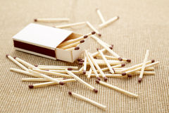 Matchbox over beige backdrop. Matchbox and some matches over a beige backdrop Royalty Free Stock Photo